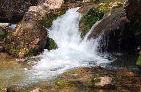 limpid: Cascades on spring mountain river (Kokkozka River, Great Crimean Canyon, Ukraine). Stock Photo
