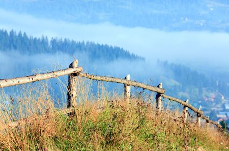 countryside landscape with wooden fence and mountain behind Stock Photo - 5870201