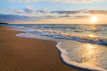 sheen: Sea  sunset surf great wave break on sandy coastline