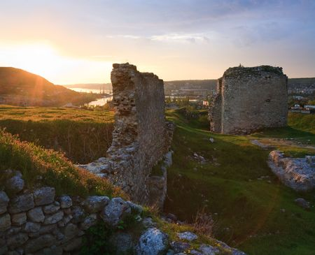 Summer sunset view of ancient  Crimean fortress (near Sevastopol Town, Crimea, Ukraine) and small sea bay behind Stock Photo - 6028861