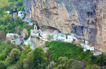 assumption: Spring view of Bakhchisaraj town and Assumption Convent in rock (Chufut Kale, Crimea, Ukraine) Stock Photo