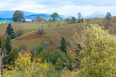 beautiful autumn mountain and small village on mountainside (Carpathian. Ukraine) photo