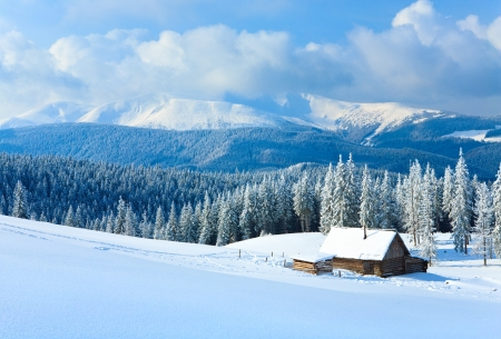 winter calm mountain landscape with shed and mount ridge behind (View to Goverla Mount, Carpathian Mountains, Ukraine) Standard-Bild