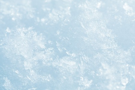 considerable: Winter snowflakes on white snow surface. Composite macro photo with considerable depth of sharpness.