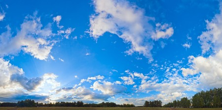 plain stitch: Evening blue sky panorama with clouds over plain and camp on forest. Seven shots stitch image.