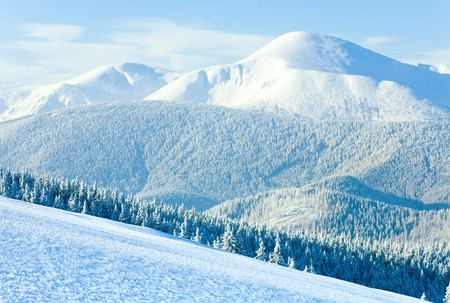 Winter Goverla Mount view and snow surface on mountainside in front.  (Carpathian Mountains, Ukraine) photo