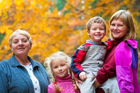 Happy family outdoor portrait in a autumn mountain walk Stock Photo - 8666808