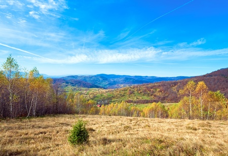 vapour: Autumn mountain country landscape with village ,birch trees and vapour trail in sky(Carpathian, Ukraine). Stock Photo