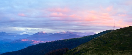 Autumn evening plateau landscape with lust golden-pink sunlight on mountains and evening glow in sky. Two shots stitch image. Stock Photo - 10548725