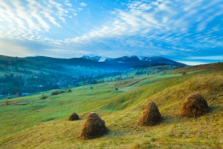Misty early daybreak in autumn Carpathian mountain, Ukraine (Goverla and Petros Mount in far) photo