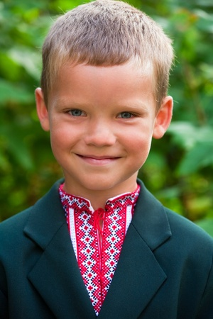sunburnt: Outdoor portrait of nice little boy before his first visit to the school (with some peel off sunburnt skin on nose) Stock Photo