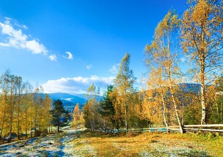 outskirts: Autumn hoarfrost on mountain village outskirts glade