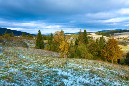 tableland: October Carpathian mountain plateau with first winter snow and autumn colorful foliage