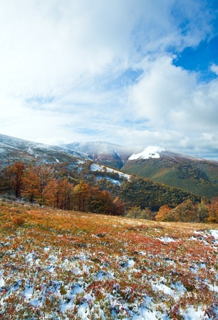 October Carpathian mountain Borghava plateau with first winter snow and autumn colorful foliage photo