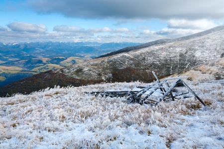 borghava: October Carpathian mountain Borghava plateau with first winter snow and wooden shed ruins Stock Photo