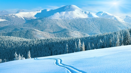Morning winter calm mountain landscape with ski track and sunshine (Goverla view - the highest mount in Ukrainian Carpathian). Four shots stitch image, 16 to 9 wide propotions. photo