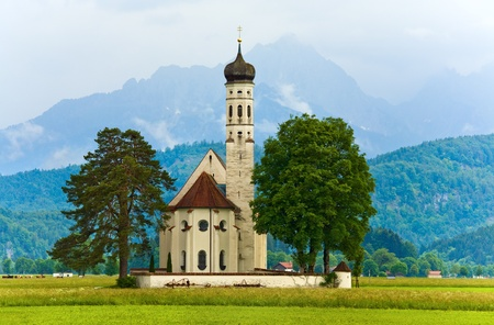 Historic medieval Neuschwanstein Castle in Bavaria (Germany) and church near
