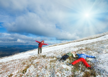 borghava: October Carpathian mountain Borghava plateau with first winter snow (and mother with children get fun)