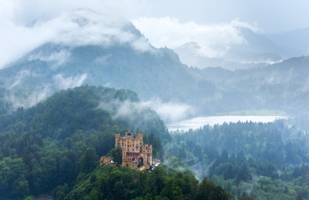 Historic medieval Neuschwanstein Castle in Bavaria (Germany). View from Neuschwanstein Palace, rain weather photo