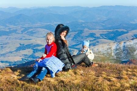 Family (mother with children) walk on autumn  mountain plateau. Stock Photo