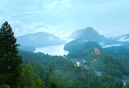 Cloudburst above historic medieval Neuschwanstein Castle in Bavaria (Germany). View from Neuschwanstein Palace. photo