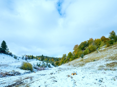 October Carpathian mountain with first winter snow on dirty road photo