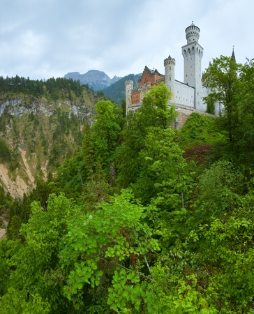 Historic medieval Neuschwanstein Castle in Bavaria (Germany).  Two shots composite picture photo