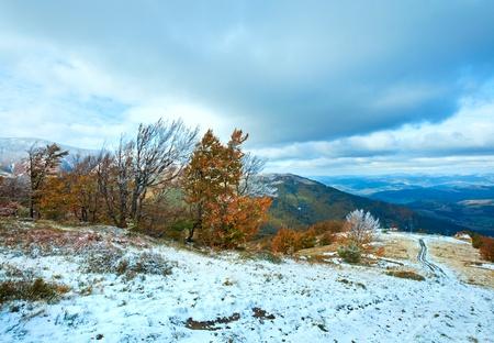 October Carpathian mountain Borghava plateau with first winter snow and autumn colorful foliage Stock Photo