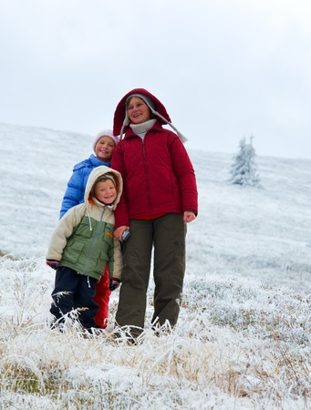 borghava: Family (mother with children) walk and play on autumn  mountain plateau with first winter snow