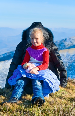 borghava: Family (mother with daughter) walk on autumn  mountain plateau.  Stock Photo