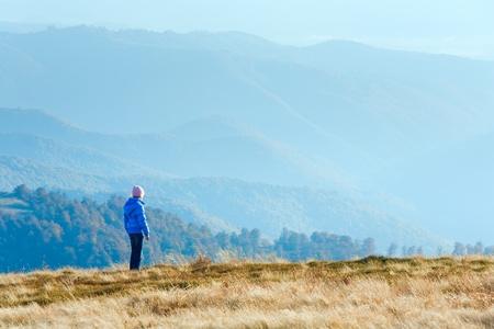 Small girl walk on autumn  mountain plateau.