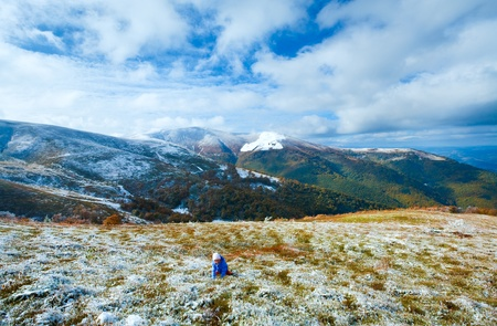 borghava: October Carpathian mountain Borghava plateau with first winter snow and playing girl on walk