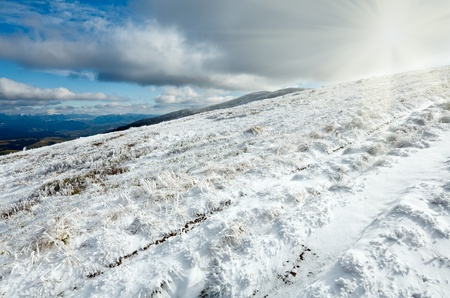 borghava: October Carpathian mountain Borghava plateau with first winter snow and sunshine in sky