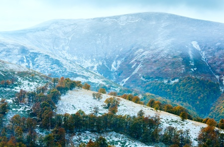 October Carpathian mountain Borghava plateau with first winter snow and autumn colorful trees