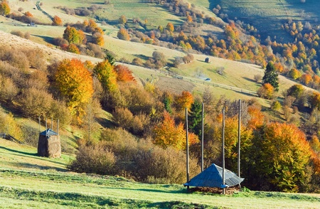 Autumn mountain country landscape with haystack on slope (Carpathian, Ukraine). Stock Photo