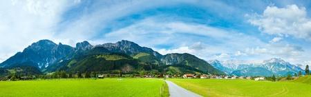 Alps mountain meadow tranquil summer view (Austria, Gosau village outskirts). Three shots stitch image.