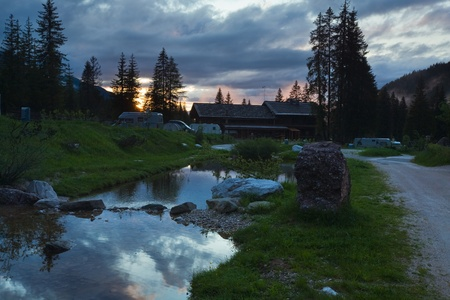camping site: Camping site in Italian dolomites. Summer sunset view.