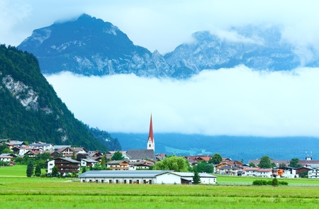 Alps mountains summer view and village in valley (Austria) photo