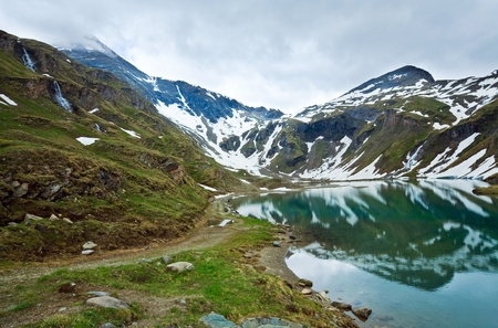 Alps mountains tranquil summer view (reflections on the lake  near Grossglockner High Alpine Road) photo
