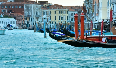 Nice summer venetian Grand Canal view with gondolas on water (Venice, Italy) photo