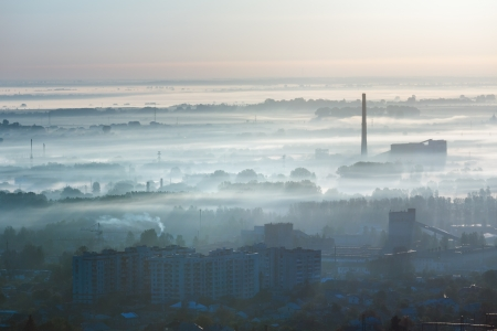 back lighting: Morning Lviv City (Ukraine) outskirts view from High Castle Hill (in first sun rays back lighting) Stock Photo