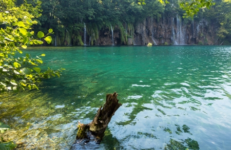Beautiful summer waterfalls and green  limpid lake in Plitvice Lakes National Park (Croatia) photo