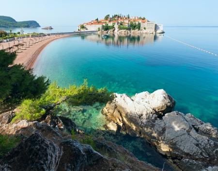 kilometres: Sveti Stefan sea islet morning view with sandy Sveti Stefan Beach (Montenegro, 6 kilometres southeast of Budva)