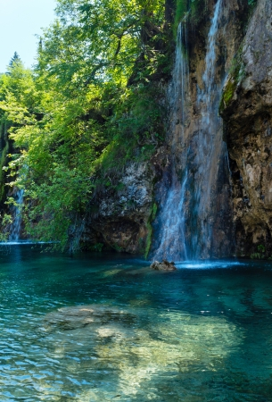 limpid: Beautiful summer waterfalls and limpid lake view in Plitvice Lakes National Park (Croatia) Stock Photo
