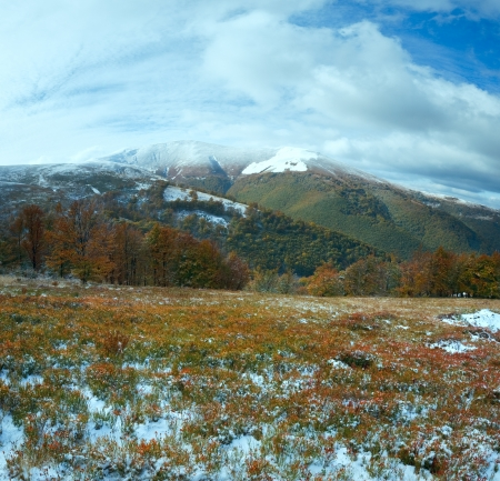 October Carpathian mountain plateau with first winter snow and autumn colourful foliage photo