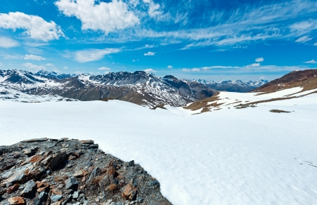Summer mountain view from Stelvio pass with snow on slope (Italy) photo