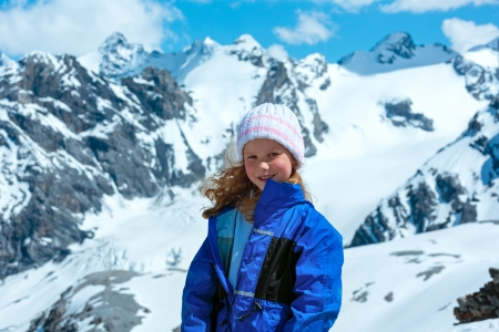 Summer mountain view from Stelvio pass with snow on slope (Italy) and girl portrait. photo