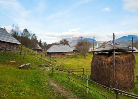 Autumn misty mountain village with wooden house (Kolochava, Carpathian , Ukraine).