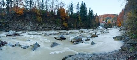 turbid: Autumn morning mountain river with turbid muddy water (Carpathian , Ukraine). Stock Photo