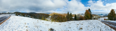 October Carpathian mountain panorama with first winter snow on dirty road. Four shots composite picture. photo